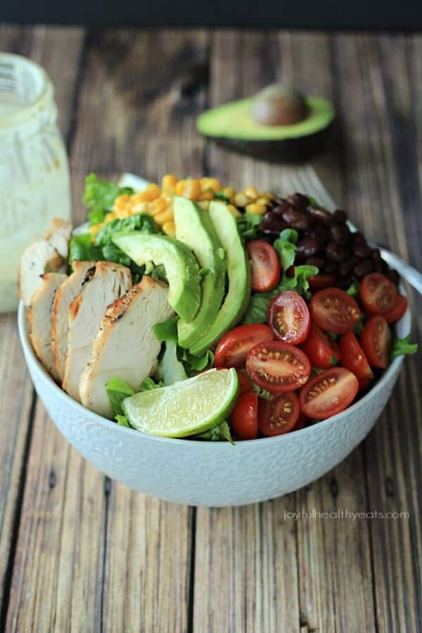 A Southwestern inspired Chopped Salad with grilled Chicken, tons of vegetables, and topped off with a Creamy Poblano Lime Ranch Dressing!