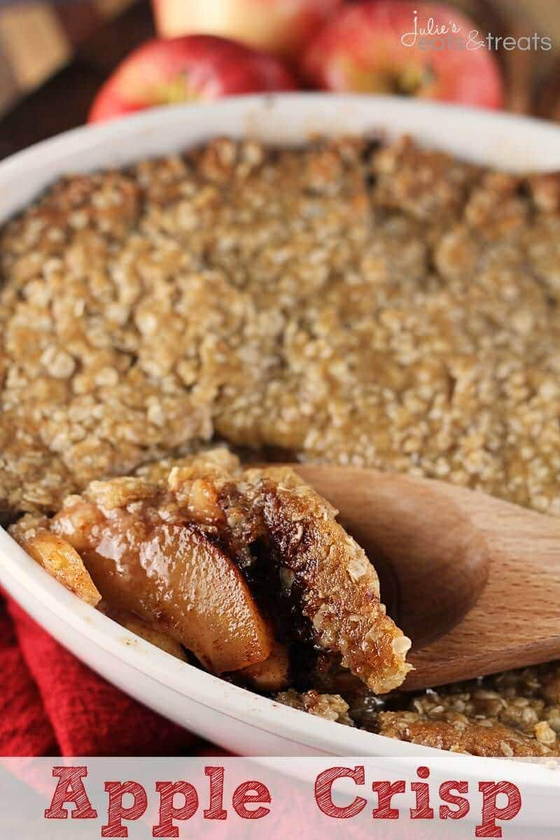 Apple Crisp being scooped from a casserole with a wood spoon