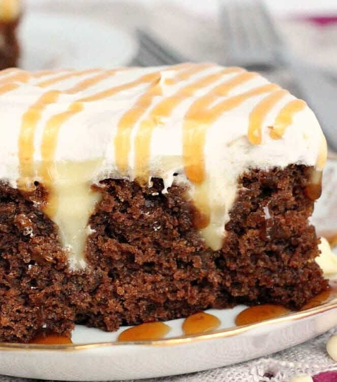 White Chocolate Gingerbread Poke Cake ~ Delicious, Moist Gingerbread Cake Layered with White Chocolate Pudding and Cool Whip!