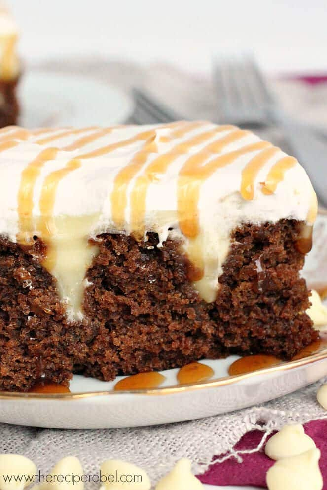 White Chocolate Gingerbread Poke Cake: moist spice cake filled with creamy white chocolate pudding and topped with whipped cream. The perfect dessert for the holidays!