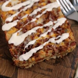 Loaf of chicken bacon ranch meatloaf on a wood board with two forks