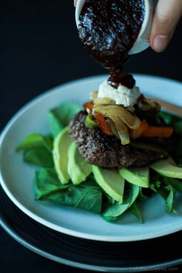 Skinny Southwestern Cheeseburger ~ On a bed of spicy fresh arugula, topped it with roasted red pepper, roasted poblano peppers, creamy goat cheese, avocado, and BBQ sauce!
