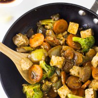 This Tofu Stir-Fry recipe is easy, nutritious and of course delicious! The vegetables are softened until almost caramelized in a honey sriracha Asian sauce!