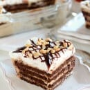 Peanut Butter Fudge Icebox Cake ~ A creamy and decadent no-bake dessert filled with layers of chocolate graham crackers, peanut butter cream, hot fudge sauce, and whipped cream!