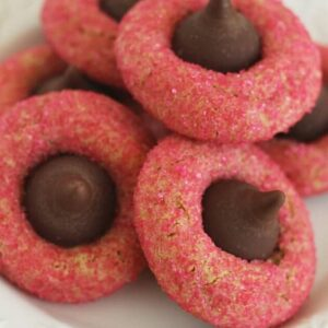 Valentine caramel kiss peanut butter blossom cookies on a white plate