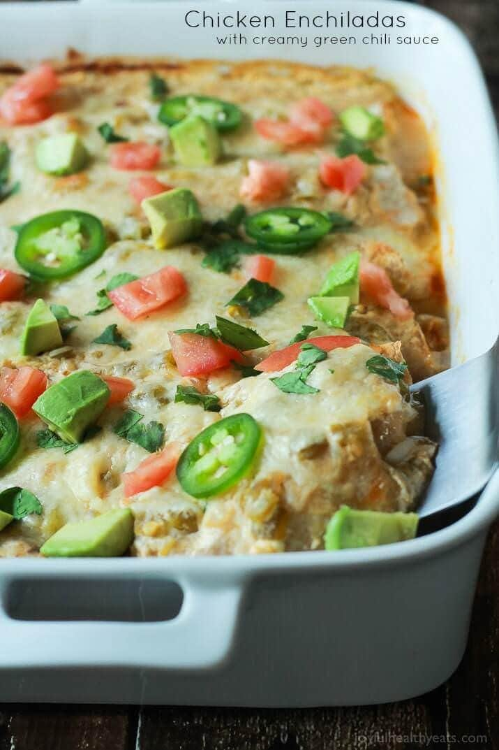 Chicken Enchiladas topped with a Creamy Green Chili Sauce made with Greek Yogurt and spicy green chilis! An easy weeknight meal that will beat going out to eat any day of the week!