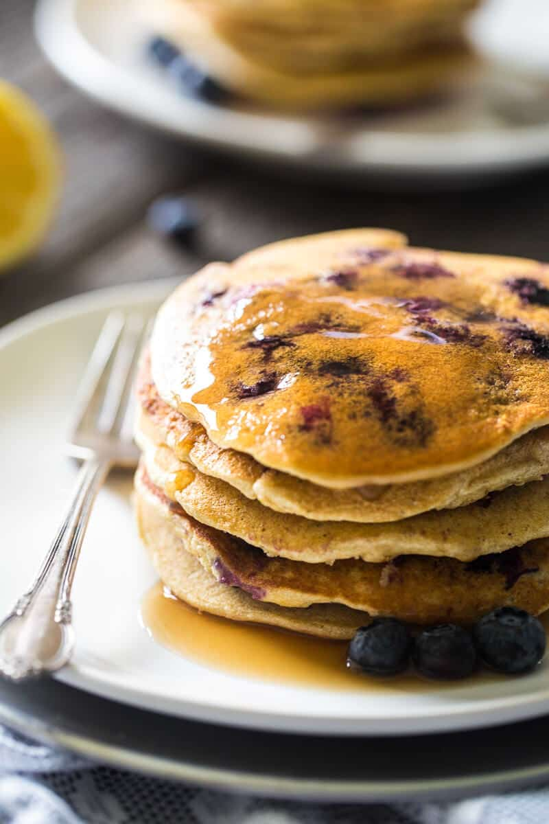 Lemon Blueberry & Quinoa Gluten Free Pancakes - loaded with blueberries, quinoa and a pop of fresh lemon! Greek yogurt makes them protein-packed and a delicious, healthy breakfast!   Julieseatsandtreats.com