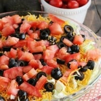 Loaded Guacamole Dip ~ Guacamole Piled High with Cheese, Salsa, Tomatoes, & Black Olives!