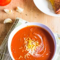 This Slow Cooker Tomato Basil Soup is creamy, rich with flavor and perfect for spring! Throw it in the Crock Pot and it will be waiting for you when you are ready to eat!