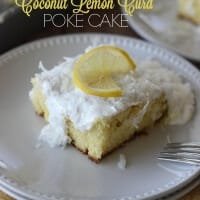 Coconut Lemon Curd Poke Cake Recipe - Filled with luscious lemon curd and topped with a 7-Minute frosting and coconut!