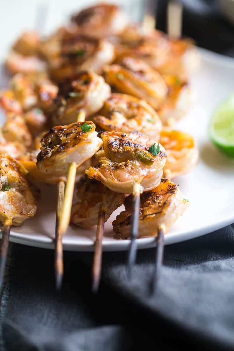 Cilantro Lime Grilled Shrimp Kebabs with Avocado Cilantro Dip – Shrimp are marinated in lime juice, honey and jalapeno pepper, then grilled for a quick and easy, healthy appetizer that's perfect for Summer! | Julieseatsandtreats.com |