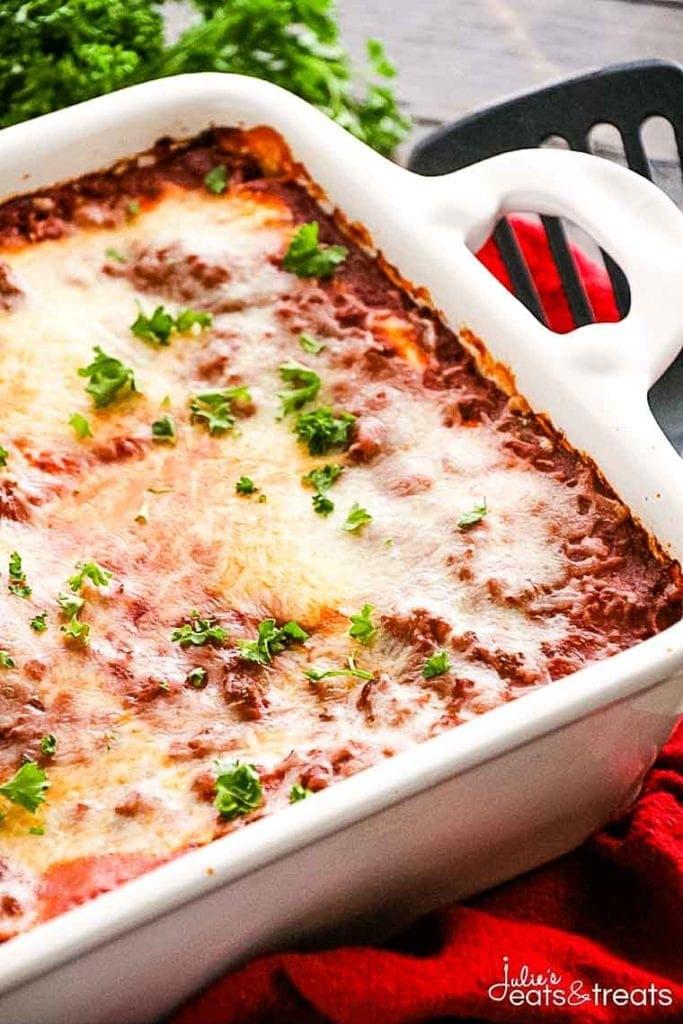 Lasagna in white casserole dish