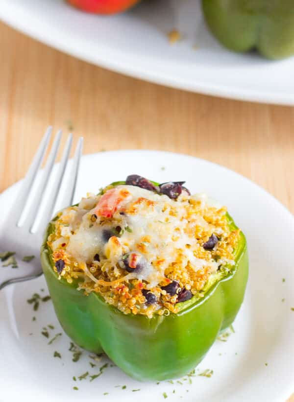 These Tex Mex Quinoa Stuffed Peppers are a healthy protein packed, delicious and easy weeknight meal for your family!