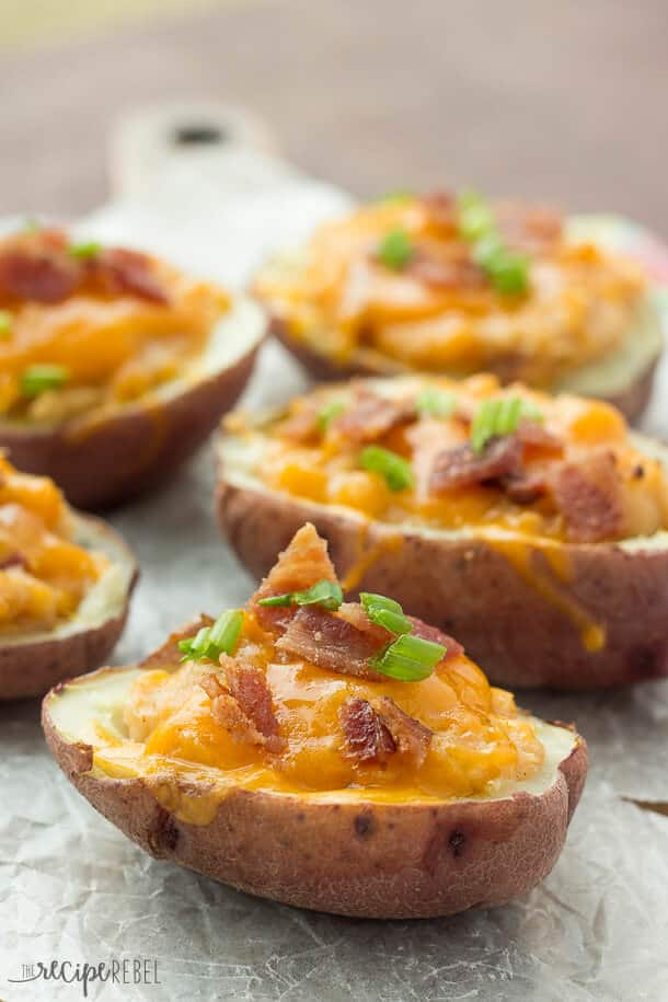 Grilled BBQ Bacon Twice Baked Potatoes: Tender potato shells stuffed with mashed potatoes flavored with barbecue sauce, bacon and cheddar cheese, and grilled to perfection! Microwaving the potatoes keeps things super easy and keeps the house cool in the summer. You can also bake them in the oven if you desire.