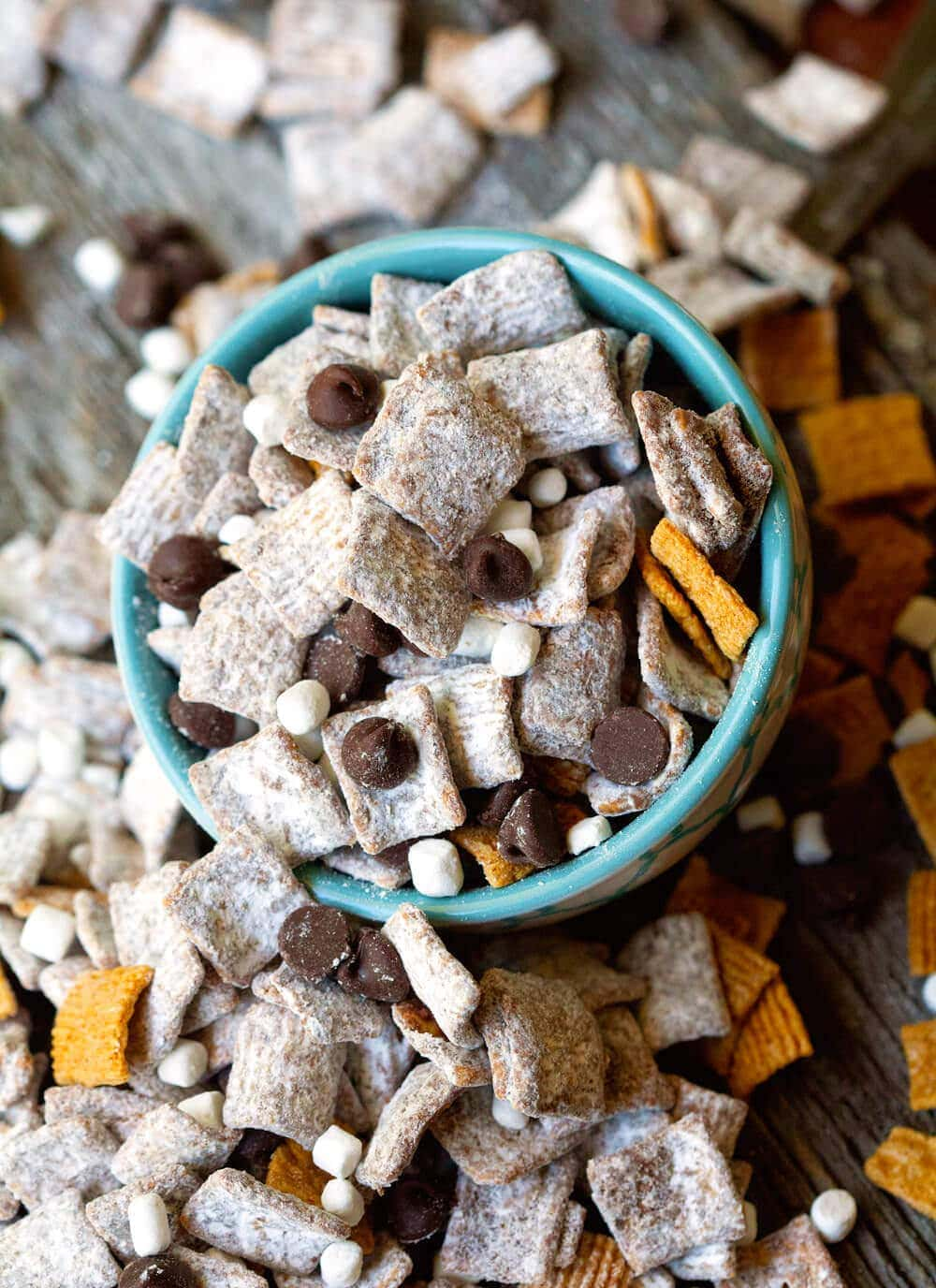 Smores Muddy Buddies is summer's favorite snack mix. You only need 5 ingredients to make this addicitng treat!