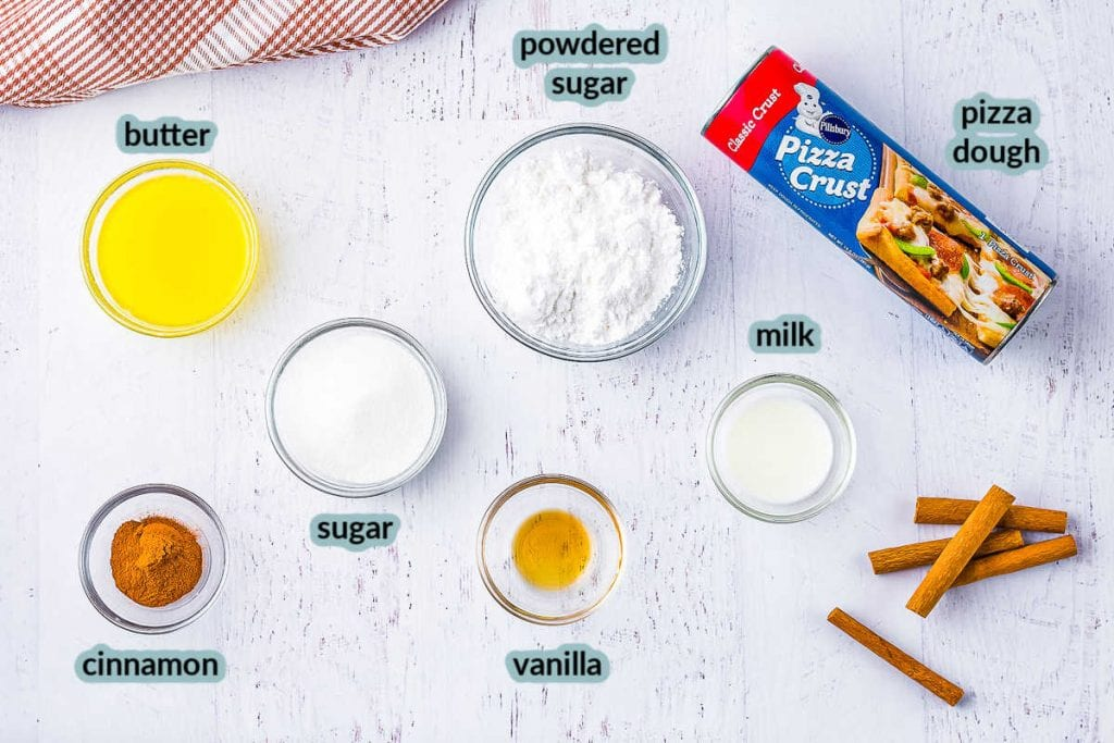 Ingredients including butter cinnamon pizza crust powdered sugar vanilla sugar milk