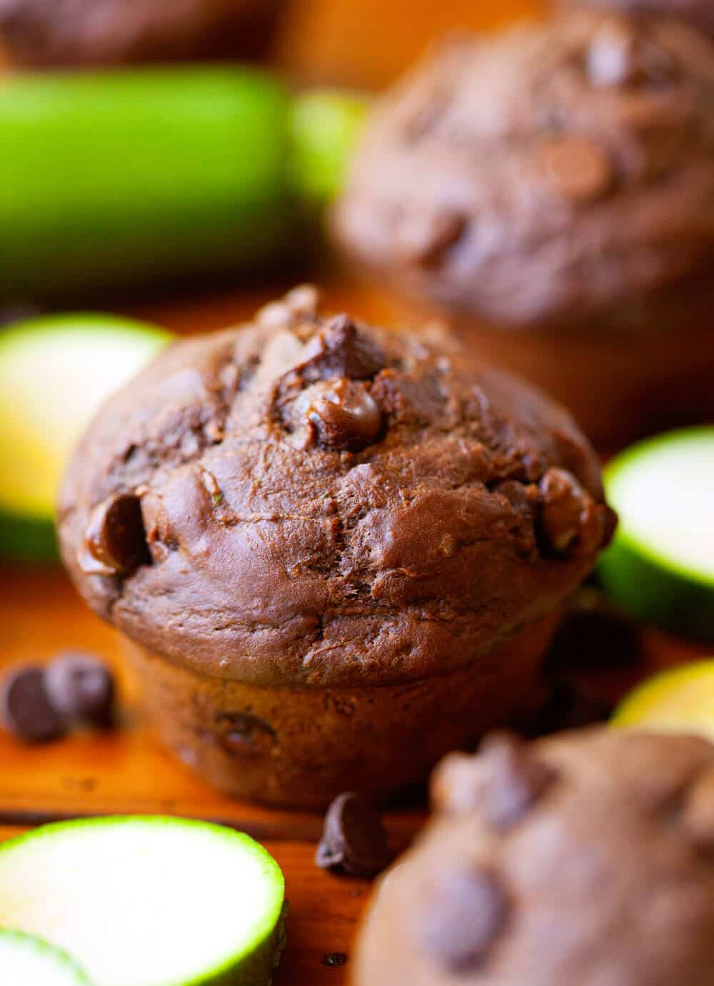 Close up image of a fresh double chocolate zucchini muffin on wooden background.