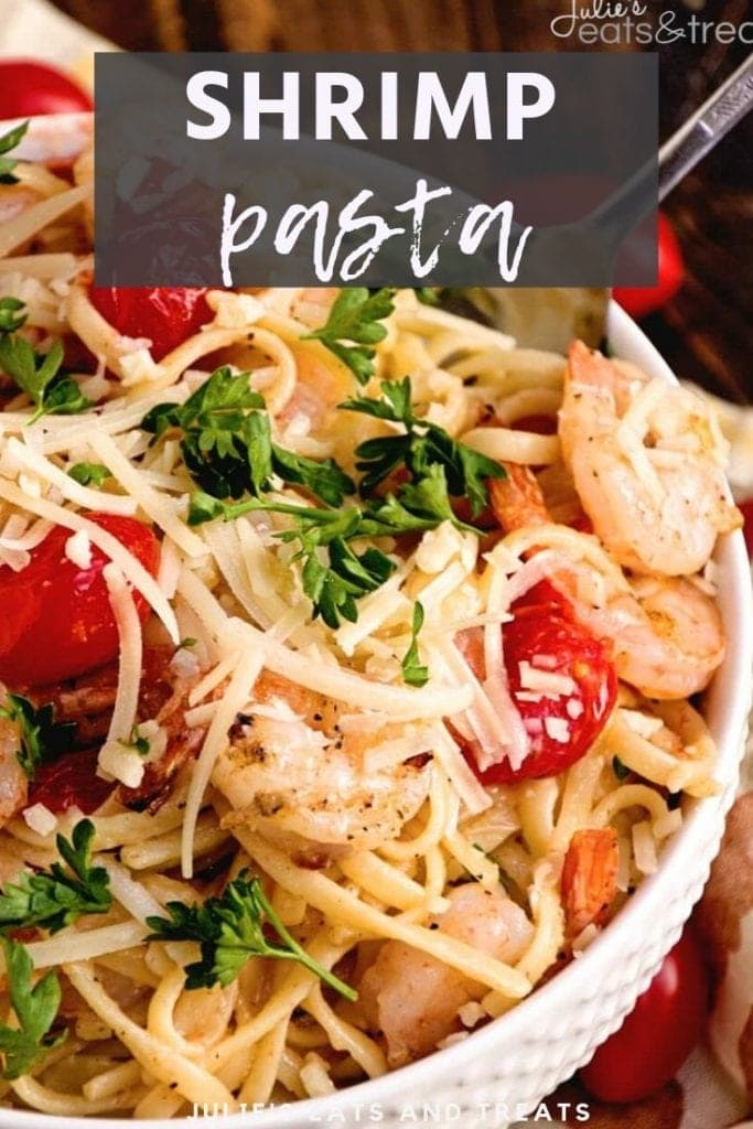 Shrimp pasta in a white bowl topped with parsley and parmesan