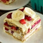 A square piece of skinny strawberry banana ice box cake on a white plate
