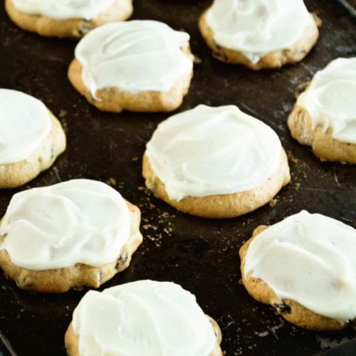 Zucchini cookies with frosting on a baking sheet