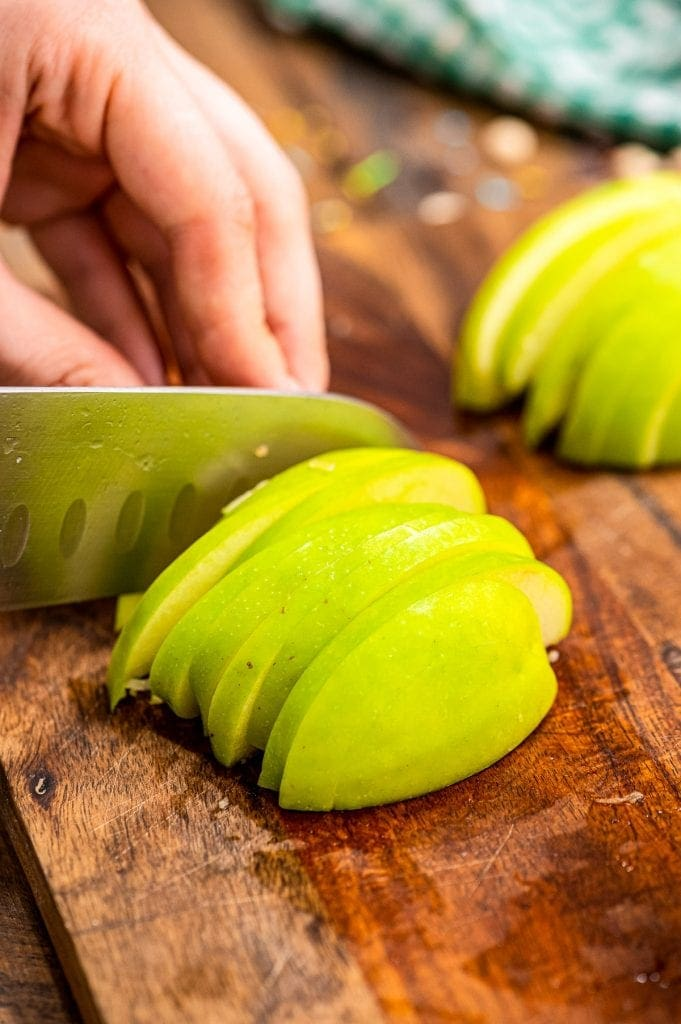 Knife thinly sliced green apple