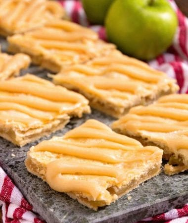 Apple Bars with Caramel Frosting ~ Soft, flaky crust stuffed with homemade apple pie filling and drizzled with caramel frosting!