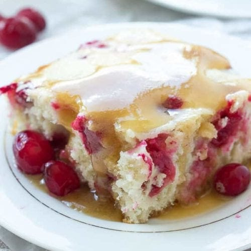 Cranberry Cake with Caramel Sauce Recipe ~ Moist vanilla cake filled with cranberries and covered in a warm caramel sauce! An elegant holiday dessert that is super easy!