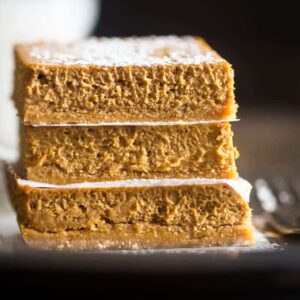 Stack of three skinny gluten free pumpkin cheesecake bars