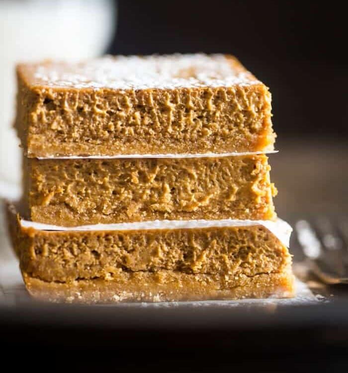 Stack of three skinny gluten free pumpkin cheesecake bars