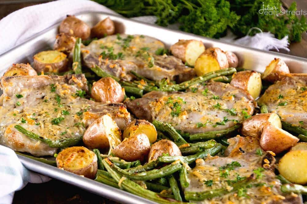 One Pan Parmesan Pork Chops and Veggies Recipe ~ Juicy Pork Chops Baked in the Oven with Potatoes and Veggies Seasoned with Garlic, Thyme and Parmesan! Dinner ready in 30 Minutes!