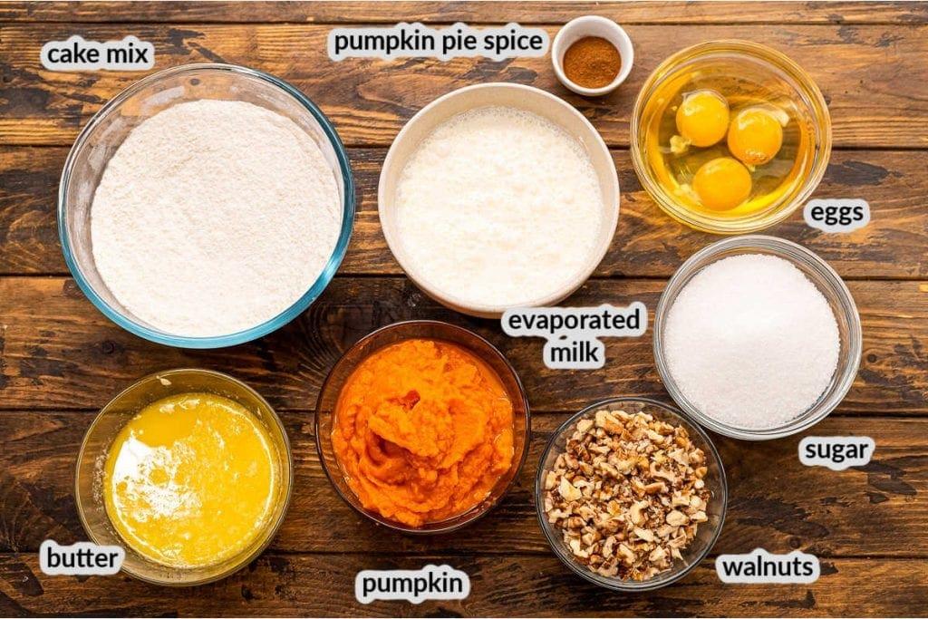 Overhead view of Pumpkin Dump Cake Ingredients in bowls.