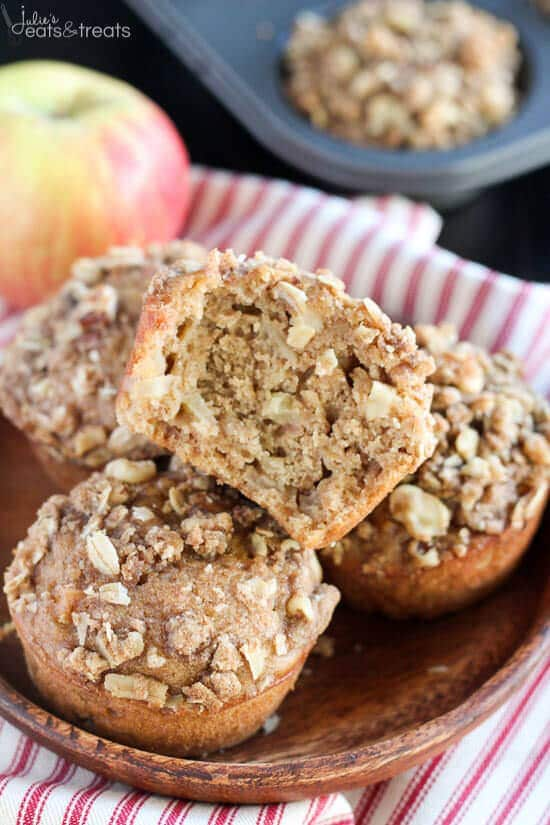 Stack of Apple Oatmeal Muffins on brown plate with one split in half