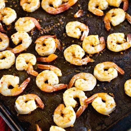 A baking sheet of cajun broiled shrimp