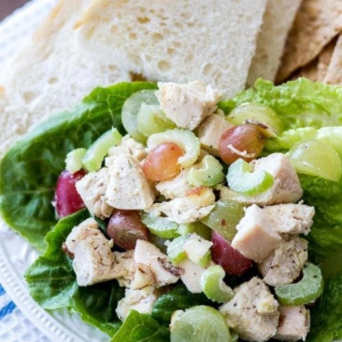 Chicken salad on a plate along with slices of bread