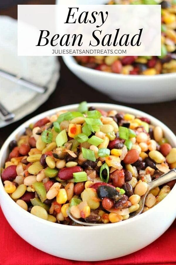 Easy bean salad in a white bowl with a spoon