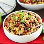 Colorful Bean Salad - A delicious array of flavors and beans brings this side dish to a whole new level. Plus it's easy to throw together on a busy night!