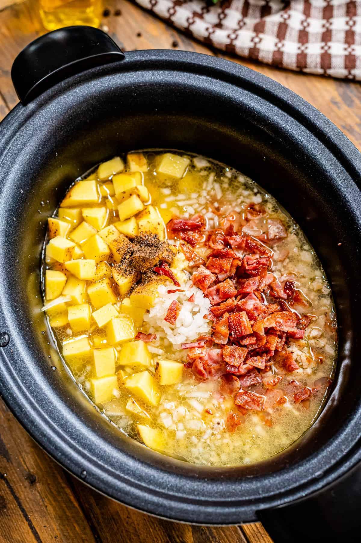 Ingredients in black crock pot to make zuppa toscana