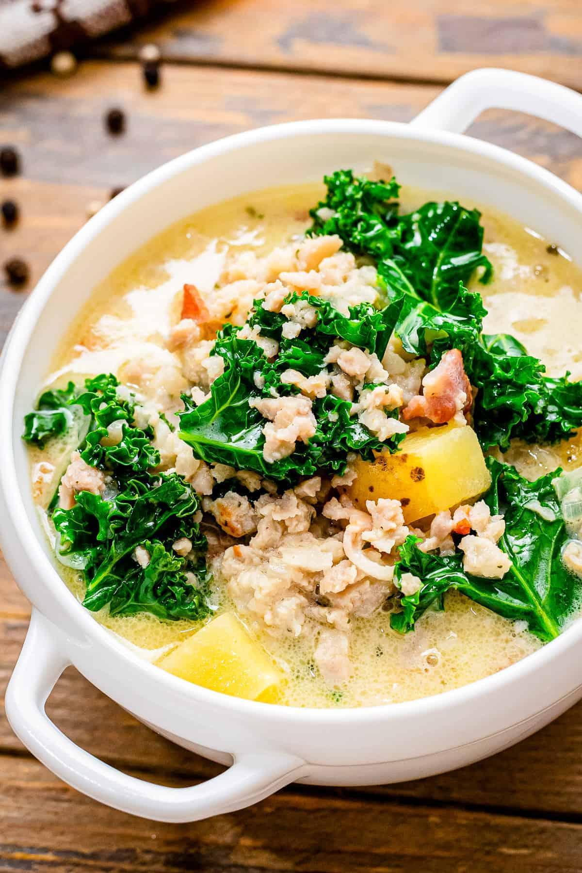 White bowl with Crock Pot Zuppa Toscana