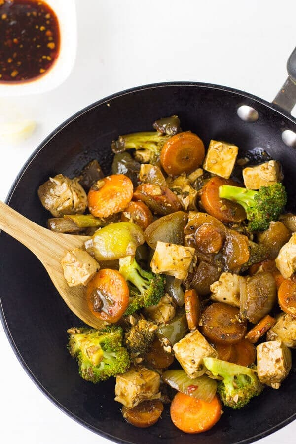 This-Tofu-Stir-Fry-recipe-is-easy-nutritious-and-of-course-delicious-The-vegetables-are-softened-until-almost-caramelised-in-a-honey-sriracha-asian-sauce-2