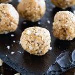 White chocolate macadamia nut energy balls on a slate tray