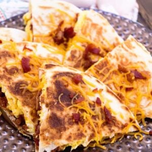 Bacon egg and cheese quesadilla slices on a plate