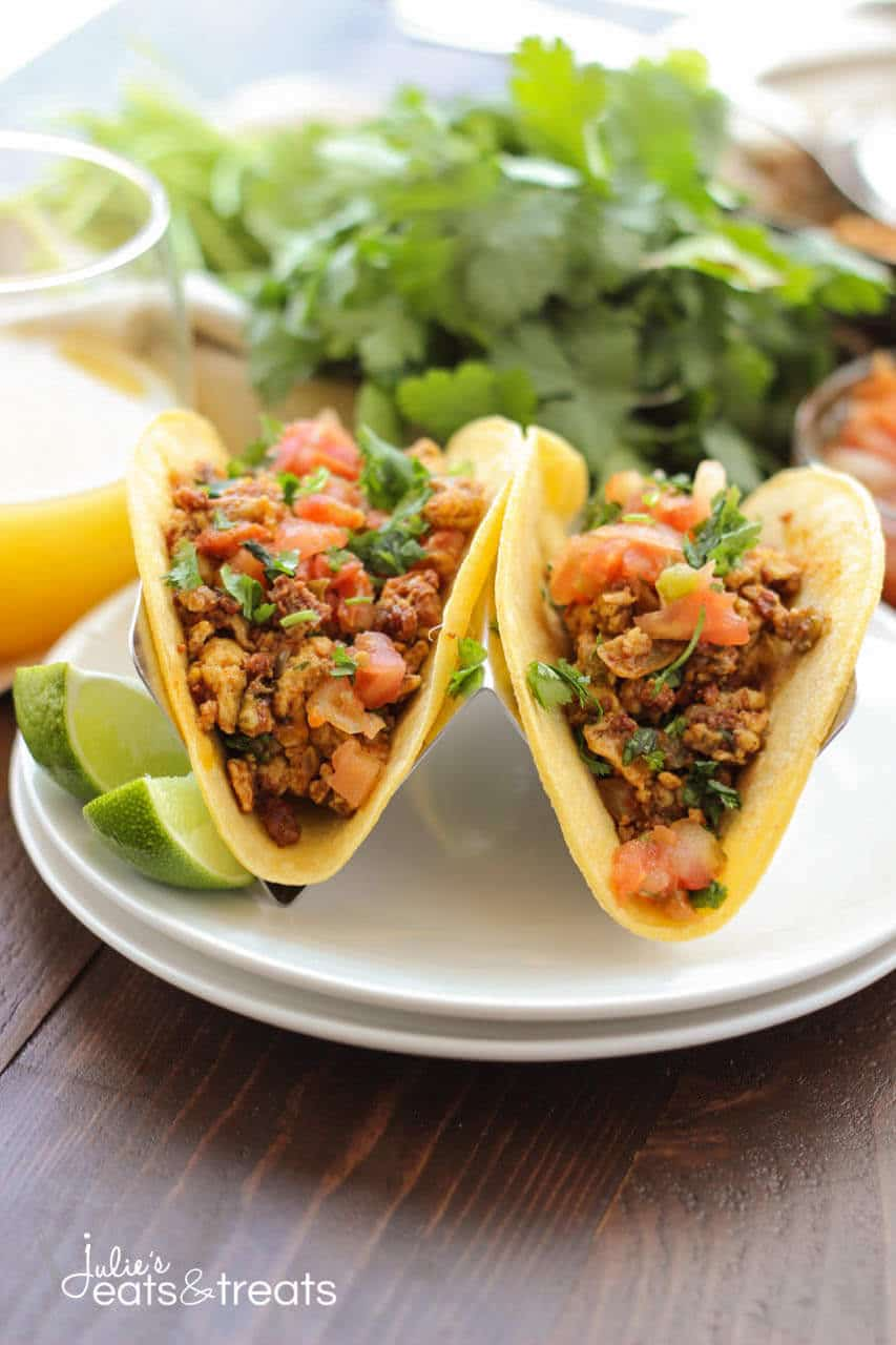 Chorizo Breakfast Tacos ~ Soft scrambled eggs mixed with chorizo and vegetables, then stuffed into a corn tortilla with beans. Topped with some salsa, pico de gallo and cheese. This is a breakfast dish you won't want to miss!