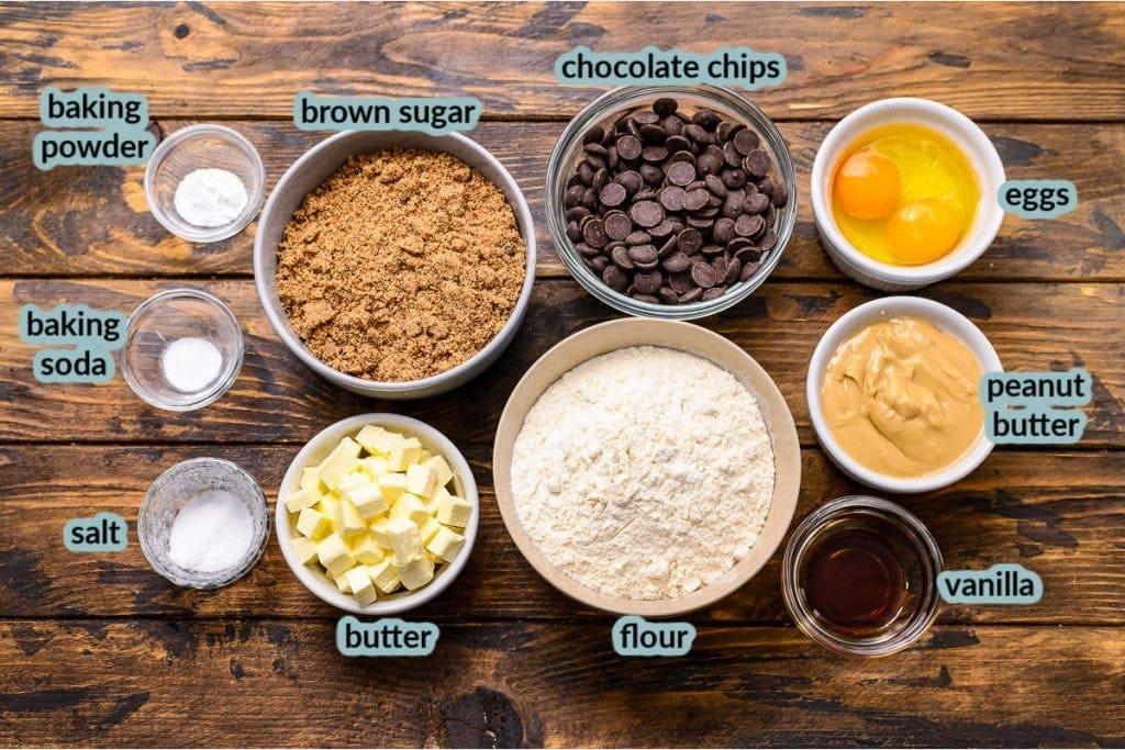 ingredients needed to make cookie bars like butter eggs flour brown sugar chocolate chips in bowls