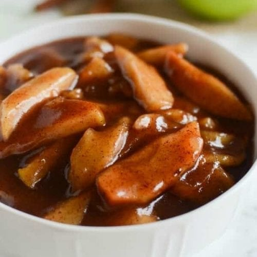 White bowl of crock pot cinnamon apples