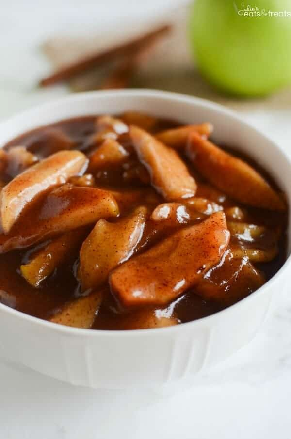 Crock Pot Cinnamon Apples - easy and delicious spiced apples! Perfect served with ice cream, on pancakes, or eaten with a spoon!