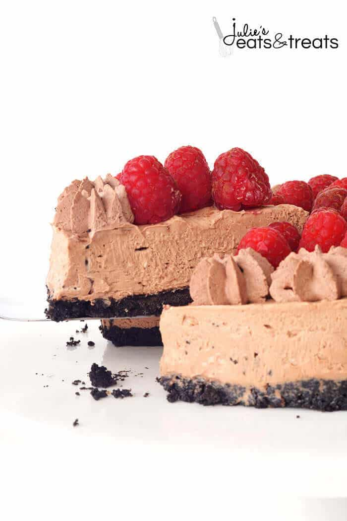 A slice of No Bake Chocolate Cheesecake topped with Raspberries.