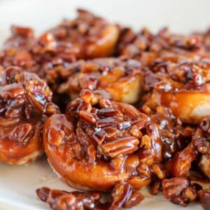 Easy caramel pecan sticky buns on a white plate