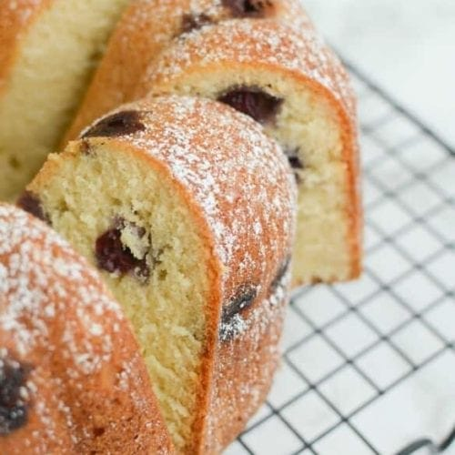 Slices of a bundt shaped blueberry sour cream pound cake on a cooling rack