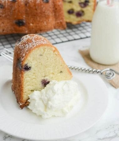 Blueberry Sour Cream Pound Cake Recipe ~ This Easy Dessert Is Perfectly Moist and Soft! Stuffed with Juicy Blueberries and Dusted with Powdered Sugar!