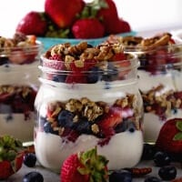 Berry Yogurt Breakfast Parfait ~ Quick, Healthy Breakfast for Mornings When You Are on the Go! Layers of Greek Yogurt, Granola, Strawberries, Blueberries, Raspberries and Pecans!